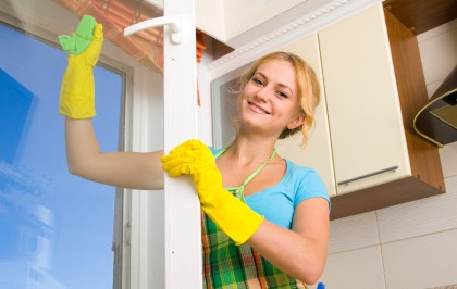 Women-cleaning-a-window--18346277